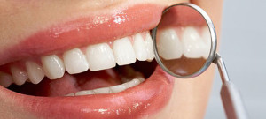 Close-up of patientís healthy smile with mirror near by